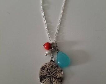 Sand dollar charm necklace