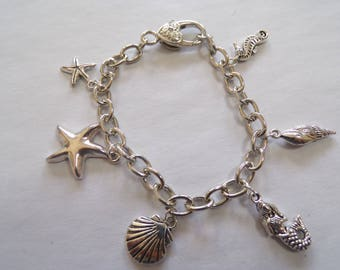 Silver plated sea creatures charm bracelet