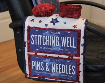 Hand sewing caddy pattern with large pockets, pincushion, and thread catcher for quilters; includes option for adding fabric license plates