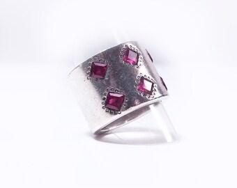 Unique silver and rubellite ring