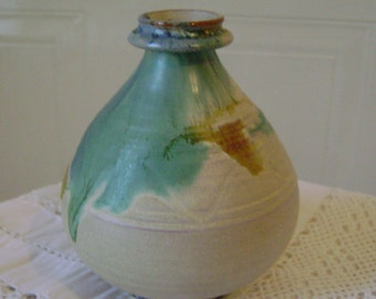 Small hand made vase. Shades of sea blue/green and sand colour