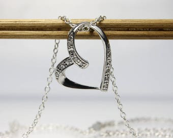 Sterling Silver Floating Heart Necklace With Cubic Zirconia On 18 Inch Cable Chain