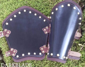 A Pair of Leather Bracers Decorated with Dome Studs suitable for Larp, Cosplay and Costume. Dark Green and Brown