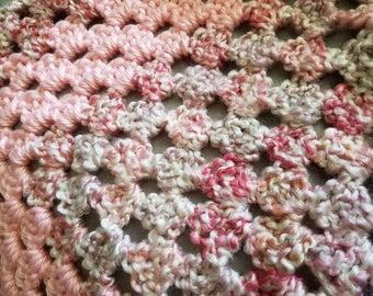 Delicate pink crochet baby blanket
