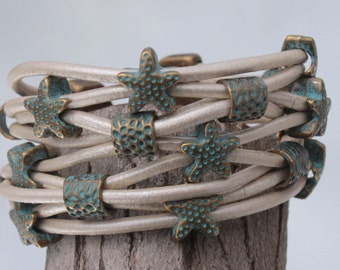 white Bracelet with patina color owls