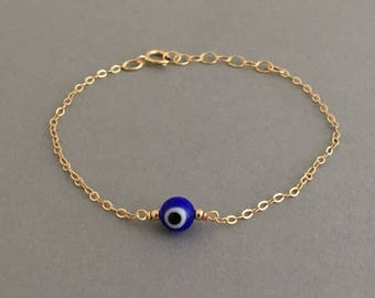Round Blue Evil Eye Bracelet available in gold, rose gold, and silver