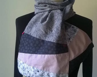 Pink scarf in grey fabric with black swirls, powder and sky blue