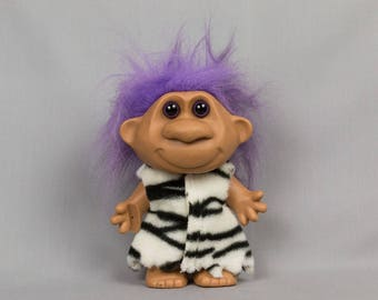 Troll Doll Girl troll doll Tiger skin removeable dress Rounded ears Vinyl body Purple hair Brown eyes black pupils 7 inches tall
