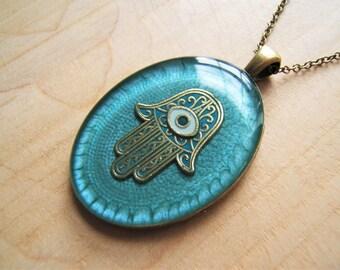 Turquoise Hamsa hand necklace. Hand of Fatima. Handmade resin pendant. Ethnic. Hand of Fatima.