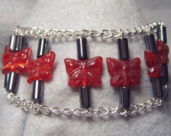 Eight Red Butterflies, glass, hematite and chain bracelet