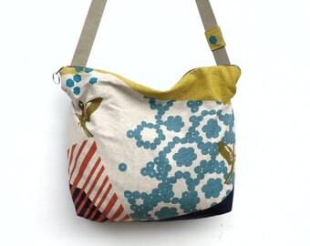 Handbag / shoulder / cross body strap / bi-material / fabric / faux leather.