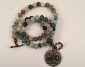 Natural stone beaded necklace with tree of knowledge pendant