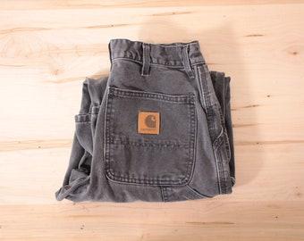 Vintage faded black Carhartt carpenter pants