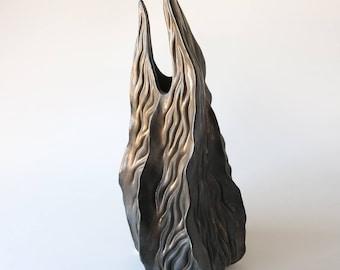 Hand carved bronze glazed & textured porcelain vessel with spiked top, sculptural vase