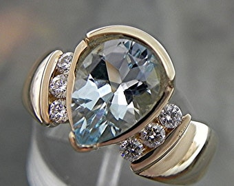 AAAA Blue Aquamarine   10x7mm  1.58 Carats   14K  Yellow Gold engagement ring with .20 ct diamonds 1589
