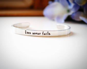 """Stamped Metal Bracelet """"love never fails"""" Sterling, Copper or Aluminum"""
