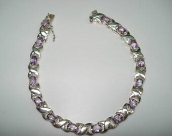 Amethyst Sterling Silver Hugs and Kisses Tennis Style Bracelet