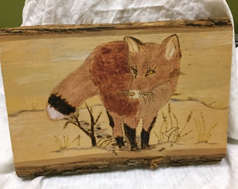 wooden plaque with woodburned image of a fox