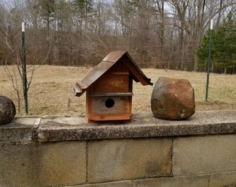 handmade rustic cedar birdhouse with old tin roof