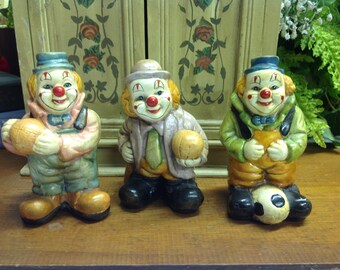 VINTAGE CERAMIC CLOWNS,Happy clowns holding basketball and soccer ball