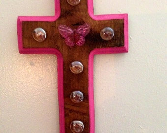 stained cross with pink edges with pearl pink stones and butterfly