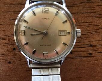 Timex vintage mens stainless steel w/date mechanical wind waterproof shock resistant dustproof made1969 watch