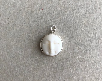Bone carved moon face