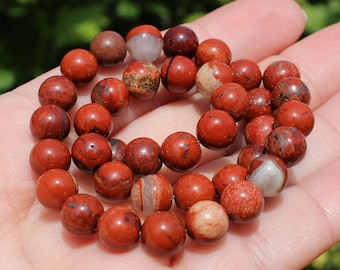 4 ROUND MULTICOLORED 8 MM BROWN JASPER BEADS.