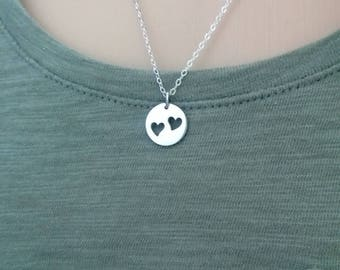 sterling silver two hearts necklace; two hearts cutout; two hearts disc necklace; silver hearts necklace; sterling silver heart necklace