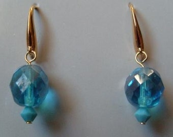 Blue Earrings on file ear hooks, the largest bead is glass and the small bead is a Swarovski crystal