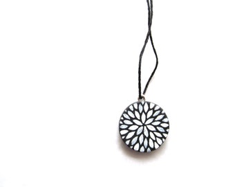 petite pendant - petal burst in black and white