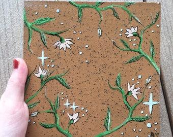 Hand painted flower design tile