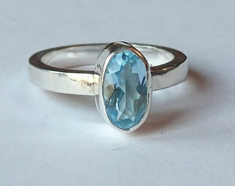 Sterling silver handmade oval blue topaz ring, hallmarked in Edinburgh