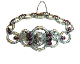 Antique French Silver And 18 Carat Gold Cherub Bracelet With Garnet Detailing