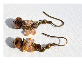 """The simplicity of these earrings """"romantic hippie chic"""" bronze with its bronze, pale pink powder tint crystals."""