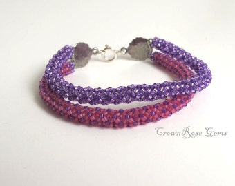 Double strand Purple and Pink Violet friendship bracelet with Sterling silver florets clasp. 2 strands. 7 1/4 inch long. 18.5cm long.