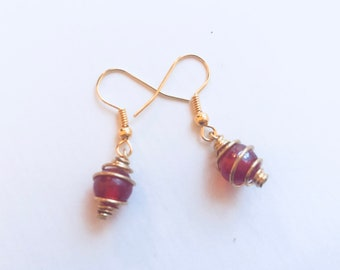 Gold cage earrings with fire orange stone