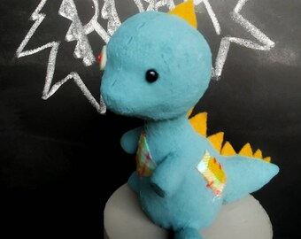 Dinosaur polymer clay cake topper figurine