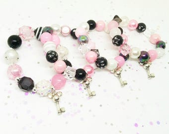 Minnie Mouse bracelets party favors in organza bags with special birthday girl bracelet!
