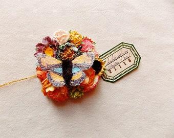 Schmetterling Kollektion orange blau gelb rosa lila grün Rosen schillernden Sternenstaub Glitzer Handarbeit Maulbeerseide blumencorsage