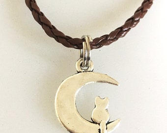 Charming cat on moon charm necklace, Antique Silver moon charm - Cute cat on the moon charm on a brown leather cord - Free Shipping