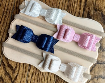 Leather bow on a nylon headband. Pink leather bow, navy leather bow, cream leather bow, white leather bow