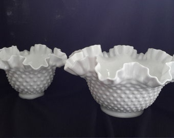 Selling as a set, 1 sm and 1 lg white milk glass hobnail vases with a ruffled rim.