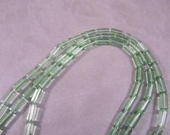 30 light green glass 10 x 4 mm tube beads