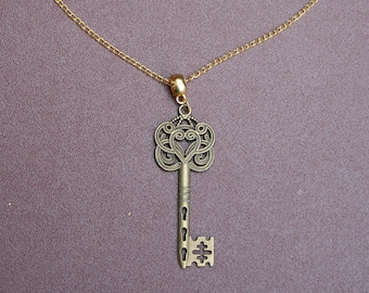 "Gold-plated key necklace with 9"" chain."