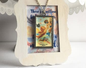 Mermaid Charm Necklace Gift on a magnetic quote sign.