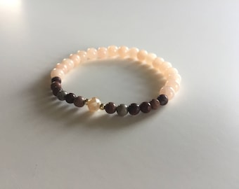 A bracelet of Gracy horse Stone and Jade