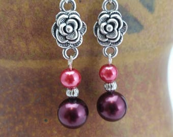 Rose accented red pearl earrings