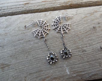 Spiderweb earrings with a spider handmade in sterling silver with a black cz stone