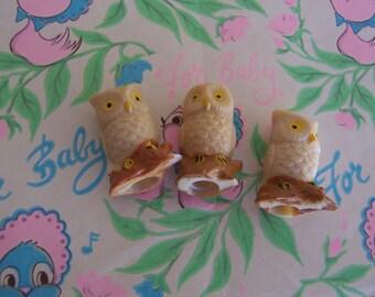 three little owl figurines